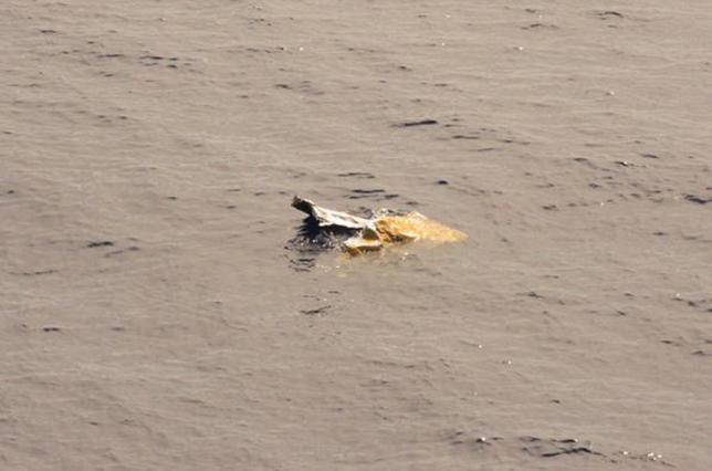 Debris is seen in the water from the El Faro search area in this handout photo provided by the US Coast Guard, October 6, 2015. REUTERS/US Coast Guard/Handout via Reuters